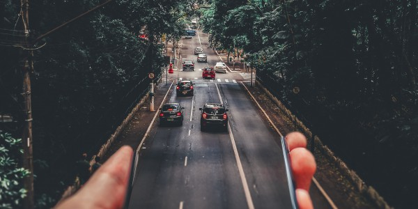 forced_perspective_photography_of_cars_running_on_road_below_799443.jpg